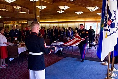 Marines from the Oregon City recruitment center fold the flag to close the Military Luncheon.