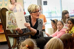 SPOKESMAN PHOTO: VERN UYETAKE - West Linn-Wilsonville Deputy Superintendent Kathy Ludwig reads to a large group of kids during Lowrie Primary School's Literacy Night.