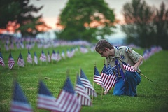 OUTLOOK FILE PHOTO - Annually, scouts with the Thunderbird District in the Cascade Pacific Council of the Boy Scouts of America plant flags on the graves of all veterans buried at Willamette National Cemetery in Portland.