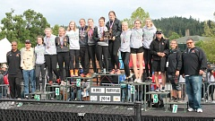 JIM BESEDA/MOLALLA PIONEER - Molalla's Desirae DesRosiers and Rachel Bring hold the Class 4A girls' track and field fourth-place trophy alongside the rest of the Indians and their coaches Saturday at Hayward Field in Eugene.