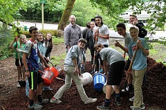 REVIEW PHOTO: ANTHONY MACUK - Volunteers from the Mormon Church in Lake Oswego get ready to spread bark chips and restore a pathway through the Campbell Native Garden as part of a community service project.
