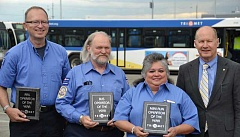 SUBMITTED PHOTO - Award winners Jeffery Evans (from left), Alex Ohly and Justina Carrillo pose with TriMet General Manager Neil McFarlane.