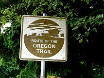 Signs direct motorists along Holcomb Boulevard, which traces the route of the Oregon Trail.