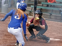 TRIBUNE PHOTO: JONATHAN HOUSE - Franklin catcher Maggie Brauckmiller is set to tag out Grants Pass' Halleigh Noga.