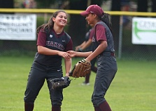 TRIBUNE PHOTO: JONATHAN HOUSE - Franklin shortstop Stephannie Lopez (left) and second baseman Yarely Guerrero-Valenzuela celebrate a double play Friday against Grants Pass.
