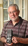STAFF PHOTOS: VERN UYETAKE  - Richard Hertzbergs mother Katherine Joseph enjoyed many careers in her lifetime, include being a photojournalist. Here he poses with a camera she gave him many years ago.