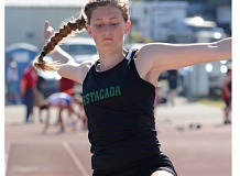 ESTACADA NEWS: DAVID BALL - Estacada senior Jessica Wheeler flies into the sand during her runner-up finish in the long jump Friday. She returned Saturday to win the triple jump at the Tri-Valley district meet.