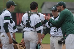 ESTACADA NEWS: PARKER LEE - Rangers coach Andrew Higgins offers a word to his infield during a break in play during last weeks 1-0 loss to Wilson High.