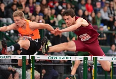 SANDY POST: DAVID BALL - Sandys Austin DeWolfe heads over the final hurdle alongside Silvertons Brock Rogers in the high hurdles final Saturday.
