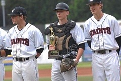 SANDY POST: PARKER LEE - Mt. Hoods Mitchell Rose accepts the teams South Region championship trophy before their quarterfinal loss to Pierce in Thursdays NWAC tournament.