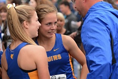 THE OUTLOOK: DAVID BALL - Barlow teammates Madison Serafini, left, and Macie Allen celebrate with Bruins coach Scott Jones after receiving their first-place medals for the 400-meter relay.