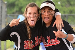 THE OUTLOOK: DAVID BALL - Mt. Hood CC rookies Maddy Newkirk, left, Jazmayne Williams keep things loud and fun in the Saints dugout.