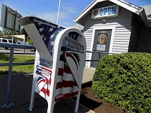 GAZETTE PHOTO: RAY PITZ - Heres what the new retired flag drop box looks like in front of Sherwoods American Legion Argonne Post 56 at Pine and First streets.