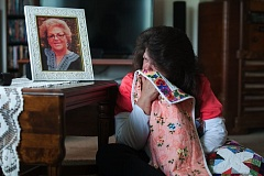 OUTLOOK PHOTO: JOSH KULLA - Theresa Robinette draws comfort from the Passage Quilt her mother received as she was dying at Legacy Mount Hood Medical Center in Gresham.