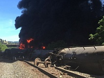 KOIN 6 NEWS PHOTO - An oil train derailed, sparking a fire, along Interstate 84 near Mosier in the Columbia River Gorge Friday afternoon.