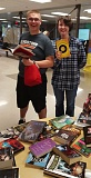Gladstone High seniors Eli Bliss and Samantha Webb choose a free book for summer vacation.