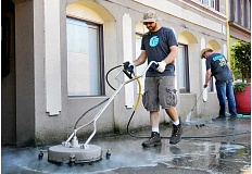 SETH GORDON - Richard Klus (center) and Terry Stearns power wash a portion of sidewalk along First Street in downtown Sunday as part of Family Life Church's Serve the City event. The church raised $25,000 at Christmas and will spend $15,000 of that on community service projects in Newberg in 2016. About 220 people participated in six groups across town.