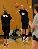 SPOKESMAN PHOTO: VERN UYETAKE - Science instructor Jay Shauer passes the ball down court at the staff/student basketball game June 2.