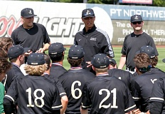 TIMES PHOTO: JONATHAN HOUSE  - Jesuit head coach Colin Griffin talks to his team after winning the Class 6A state baseball championship  on Saturday at Volcanoes Stadium.