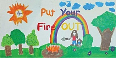 SUBMITTED PHOTO - Youths in the Kids Club have created fire prevention posters, several of which have been made into signs that will be put up along forest and grassland roads this summer.