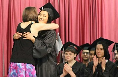 SPOKESMAN PHOTO: ANDREW KILSTROM - Kim Waldman gets a hug before receiving her diploma. Waldman will attend Portland Community College in the fall and plans to explore nursing as a career path.