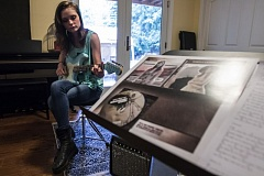 TIMES PHOTO: JONATHAN HOUSE - Singer-songwriter Josephine Relli plays the guitar at her house in Garden Home.
