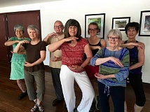 SUBMITTED PHOTO  - From left, Joyce Jacobsen, Jeannie Woehl, Jack Wright, Carol Middendorff, Jenna Steele, Alice Johansson and instructor Sharon Miller stand in the Embrace the Moon pose with a tai chi smile.