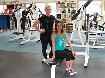 JIM BESEDA/MOLALLA PIONEER - Cutting Edge Fitness members Shawna Hale (standing) and Nicole Hughson have qualified for the Oct. 6-9 APA-WPA World Championships powerlifting event in Clackamas.