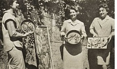 REVIEW FILE PHOTO - Festival artwork is displayed in 1963 by Mrs. Davis Jackson (from left), Mrs. Frank Manglesdorf and Mrs. Hull Dolson. In a sign of the times, The Review did not refer to the women by their own first names.