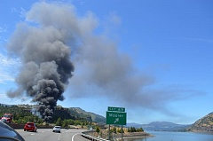 COURTESY PHOTO: COLUMBIA RIVERKEEPER - A derailed oil train fire sent a plume of black smoke into the sky June 3 near the town of Mosier in the Columbia River Gorge. ODOT officials want a moratorium on oil trains in the Gorge until tracks can be inspected for safety issues.
