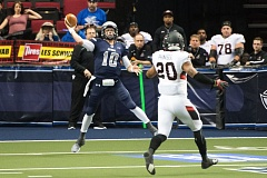 TRIBUNE PHOTO: CHRISTOPHER OERTELL - Portland Steel quarterback Shane Austin launches a pass against Cleveland.
