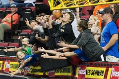 TRIBUNE PHOTO: CHRISTOPHER OERTELL - Fans go for the ball on an extra-point kick during Saturday nights Arena Football League game at Moda Center.