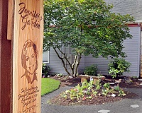 GARY ALLEN - Jennifer's Garden was created in memory of Jennifer Huston, a Dundee woman who took her own life in 2014. The space at the Hillside Inn on North Main Street in Newberg includes a produce garden, a social gathering space and a memorial garden, which is open to the public. It was dedicated in a ceremony June 5.