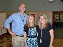 SUBMITTED PHOTO: JOHN WENDLAND - Shari Huffmaster (center) poses with Lakeridge High Assistant Principal John Parke and Principal Jennifer Schiele at a retirement party on June 6. Huffmaster's last day after 25 years with the district will be June 30.