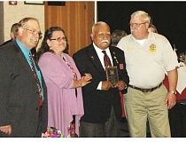 MOLALLA VFW - Pictured from left to right: 2016/2017 Commander Richard E. Halverson, Patricia Carroll, Ron Jagodnik and Commander Juan M. Palacios at the 2016 state convention awards banquet last week.