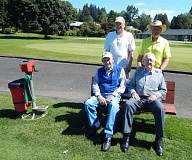 BARBARA SHERMAN - Most golfers prefer playing in the sun to playing in the rain, including this foursome - (front row, from left) Frank Passmore and Vern Coats, and (back row, from left) Al Reu and Bob Olmstead.