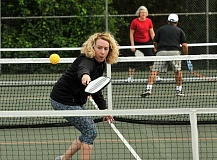 REVIEW PHOTO: VERN UYETAKE - Kerin Larson returns a serve during a recent match in George Rogers Park, where the Lake Oswego Pickleball Club hosts regular play sessions.