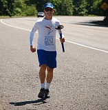 COURTESY PHOTO: SRI CHINMOY PEACE RUN - Pujari Schaeffer of San Diego carries the Sri Chinmoy Peace Run torch as the 10,000-mile journey passes through Scappoose on Sunday, June 19.