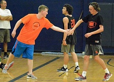 SPOTLIGHT PHOTO: JAKE MCNEAL - New Scappoose boys' basketball coach Weston Powers and Indians junior guard Tanner Kramer exchange high-fives during a 49-44 summer ball loss to host Banks on Tuesday.