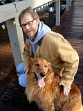 SUBMITTED PHOTO - Mikal Apenes, shown here with his dog Lucy, served as the president of the Hillsdale Neighborhood Association for four years.
