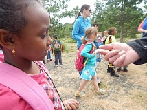 BARBARA SHERMAN - Deer Creek kindergartner Lubna looks at a bug up close, one of many critters the kids encountered on an end-of-the-school-year field trip to the Tualatin River National Wildlife Refuge.