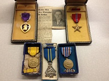 GLADSTONE PD - Lt. Colonel Frank Wilson's medals, found with a historic news article.