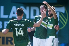 TRIBUNE PHOTO: JOSH KULLA - Diego Valeri (right) is greeted by teammates after scoring the winning goal Sunday against Houston on a penalty kick in stoppage time. The Timbers beat the Dynamo 3-2 after falling behind 2-0 in the first half and rallying in the second.