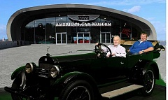 COURTESY OF JIM HAYNES FAMILY - Jim Haynes poses with his son Scott in front of America's Car Museum