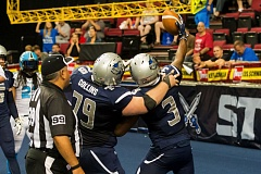 TRIBUNE PHOTO: CHRISTOPHER OERTELL - Portland Steel center John Collins (left) celebrates with Rashaad Carter after one of the receiver's three touchdown catches Monday night at Moda Center.