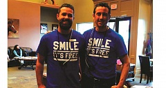 ANGELICA TRUE - Fountain Valley Dental's Dr. Brendon Bell (left) and Dr. Ben Whitted provided free dental care to 80 patients during the office's Free Dental Day Friday