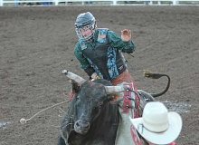 JIM BESEDA/MOLALLA PIONEER - Bull rider Montana Barlow of Eden, Idaho, rides Gilldini during Saturday's Challenge of Champions Tour stop at the Molalla Buckeroo rodeo grounds.