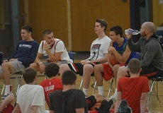 SPOKESMAN PHOTO: COREY BUCHANAN - Left to right: Harrison Steiger (class of 2017), Dylan Jordan ('16), Thomas Walter ('15), Chris Riewald ('16), and Aaron Koford  ('10) talked to youth basketball players during the camp.