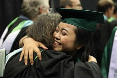 CONNECTION PHOTO: KELSEY O'HALLORAN - Ari Widiastuti embraces a Wilson High staff member during the ceremony.
