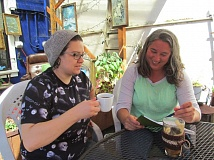 PHOTO BY ELLEN SPITALERI - Lisa Halcom, left, owner of Happyrock Coffee, and Nancy Slavin, organizer of The Other Side Reading Salon, plan for the next reading salon.